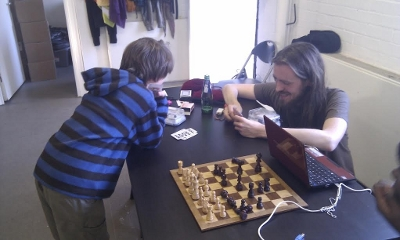 Two people play chess using the heart rate turn timers