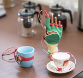 Galvanic skin response measuring cups and glove.